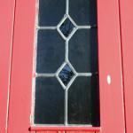 window in red door
